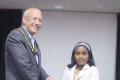 Under 10 British Girls Champion Tarini Jayaearna receiving her trophy from Brian Coffey